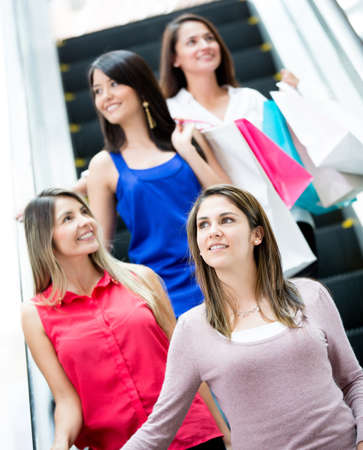 Women at a shopping center on the escalators photo