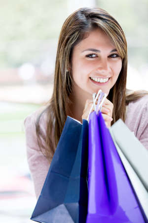 Woman holding shopping bags and looking very happy Stock Photo - 16848468