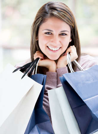 Happy female shopper holding shopping bags and smiling Stock Photo - 16848442