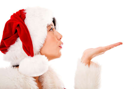 Mrs Claus blowing Christmas kisses - isolated over a white background Stock Photo - 16848445