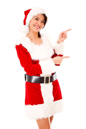 mrs: Female Santa pointing to the side - isolated over a white background Stock Photo
