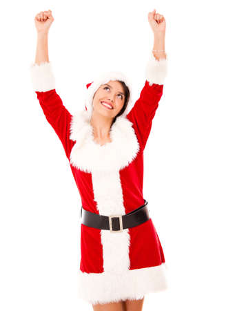 Excited female Santa with arms up - isolated over a white background Stock Photo - 16848435
