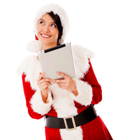 Thoughtful Mrs Claus with a tablet computer - isolated over a white background photo