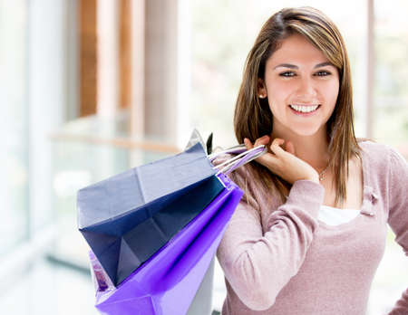 Happy female shopper at the shopping center Stock Photo - 16848460
