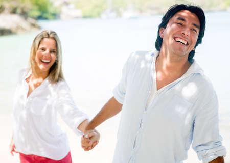 Happy couple enjoying their holidays at the beach Stock Photo - 17541213
