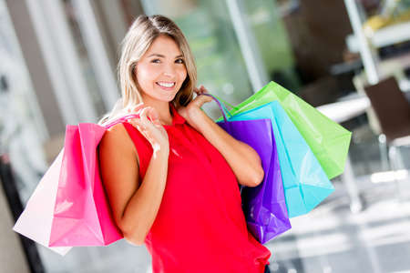 Shopping woman looking very happy at the mall Stock Photo - 17482412