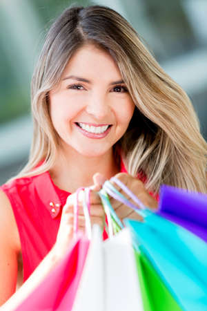 Woman holding shopping bags looking very happy Stock Photo - 17482415