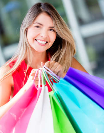 Happy woman shopping holding purchases in bags Stock Photo - 17482413