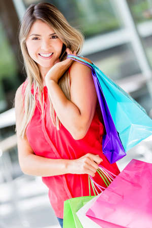 Beautiful happy woman on a shopping spree photo