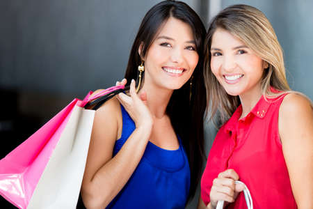 Beautiful shopping women looking very happy photo