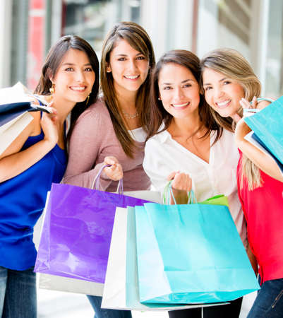 Group of shopping women at the mall smiling Stock Photo - 17482280