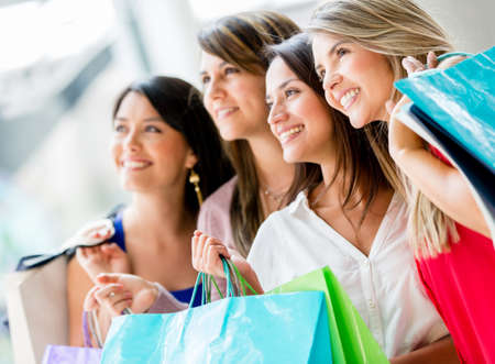 Group of girl friends shopping and looking very happy Stock Photo - 17482273