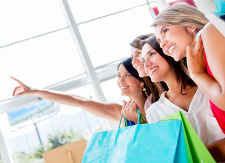 Women at the shopping center pointing away at something Stock Photo - 17482422