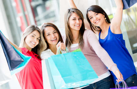Happy group of shopping women with arms up Stock Photo - 17425393