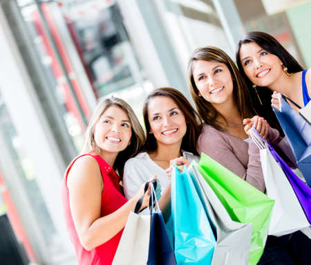 Group of women looking away at the shopping center Stock Photo - 17425381