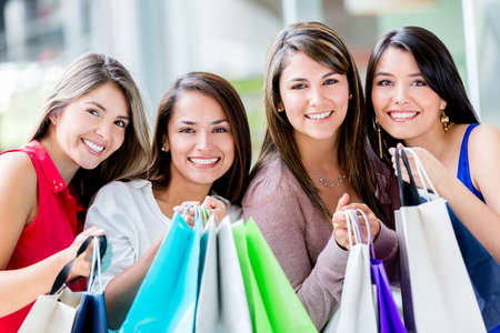 Beautiful group of shopping girls with bags Stock Photo - 17425356