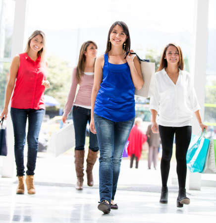 spree: Beautiful group of shopping women walking at the mall Stock Photo