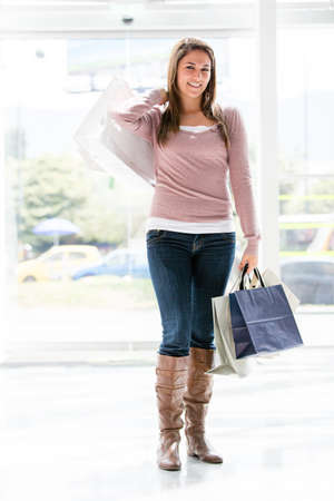 Shopping woman holding bags and smiling Stock Photo - 17425385