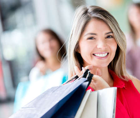 Beautiful shopping girl holding bags and smiling Stock Photo - 17425383