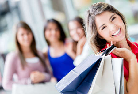 Happy shopping woman with a group of friends Stock Photo - 17405966