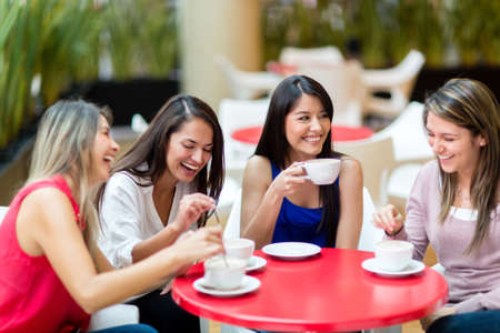 conversations: Group of girl friends meeting for coffee and talk