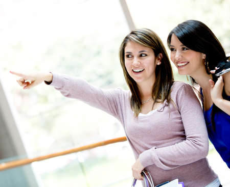 Women pointing away at the shopping center Stock Photo - 17425376