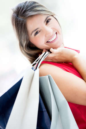 Gorgeous shopping girl holding bags and smiling photo