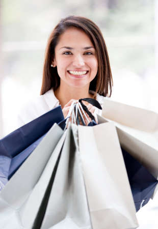 Woman holding shopping bags looking very happy Stock Photo - 17405967