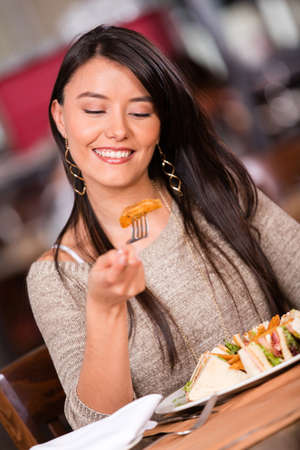 Happy woman having dinner at a restaurant Stock Photo - 17425355