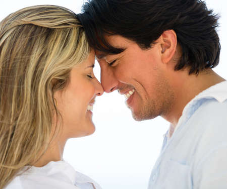 eskimo woman: Portrait of a cute loving couple looking happy Stock Photo