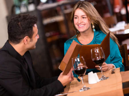 Couple on a date eating at a restaurant photo