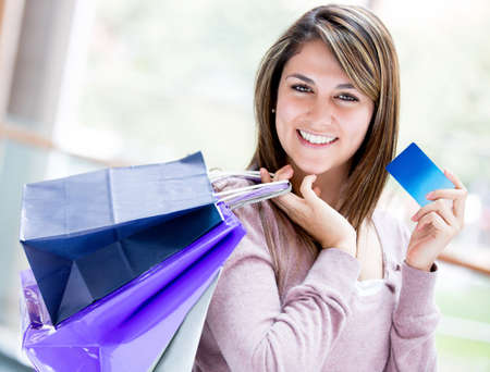 Happy woman shopping by credit card and smiling Stock Photo - 17505058