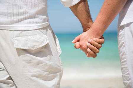 Loving couple holding hands at the beach Stock Photo - 17505220