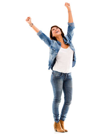 Excited woman celebrating with arms up - isolated over a white background photo