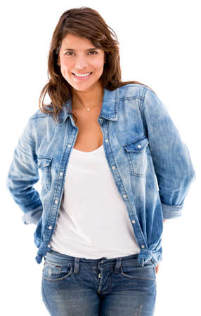 Beautiful woman in denim and smiling - isolated over white photo