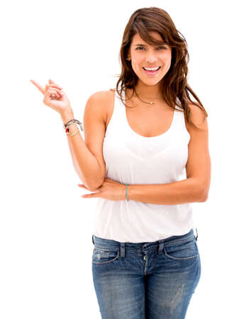 Happy woman pointing to the side - isolated over a white background photo