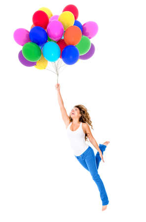 woman flying: Happy woman holding balloons - isolated over a white background Stock Photo