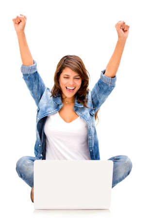Happy woman with a computer - isolated over a white background photo