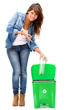 Woman recycling a plastic bottle - isolated over a white background photo