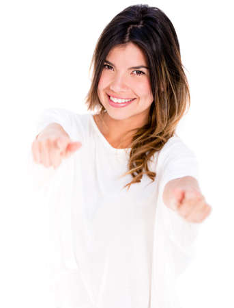 Woman pointing to the camera - isolated over a white background photo