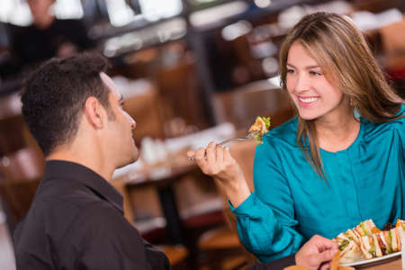 Woman having dinner with her boyfriend at a restaurant photo