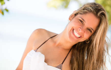 Happy woman at the beach having fun and smiling Stock Photo - 17566847