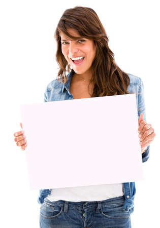 Casual woman holding a white banner and smiling - isolated photo