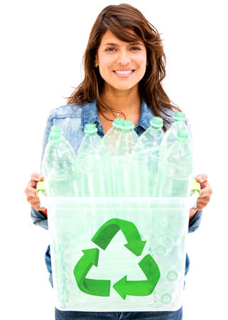 Woman recycling plastic bottles in a bin - isolated over white photo