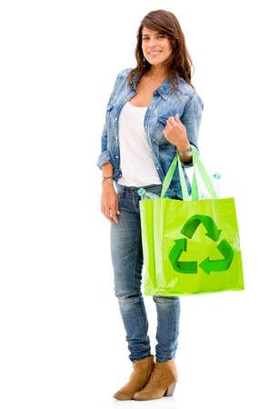 reusable: Donna con una borsa riutilizzabile - isolato su uno sfondo bianco Archivio Fotografico