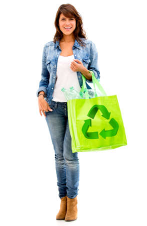Ecological woman with a green bag - isolated over white Stock Photo - 17620765