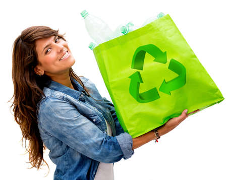 ecofriendly: Woman with an ecological bag - isolated over a white background