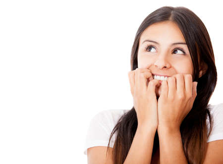 preoccupied: Anxious woman biting her nails - isolated over white Stock Photo