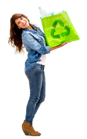 Woman with a recycle bag - isolated over a white background photo