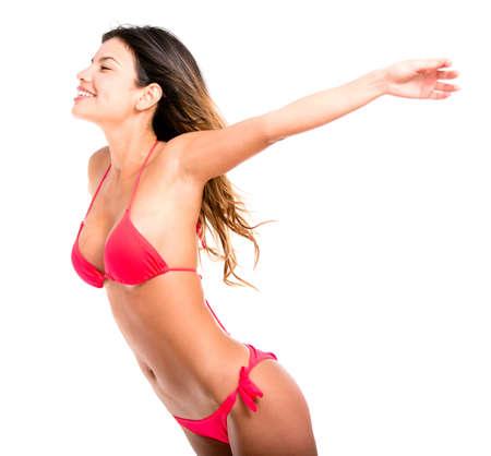 ni�as en bikini: Mujer feliz en vacaciones que llevaba un bikini - aislados en blanco